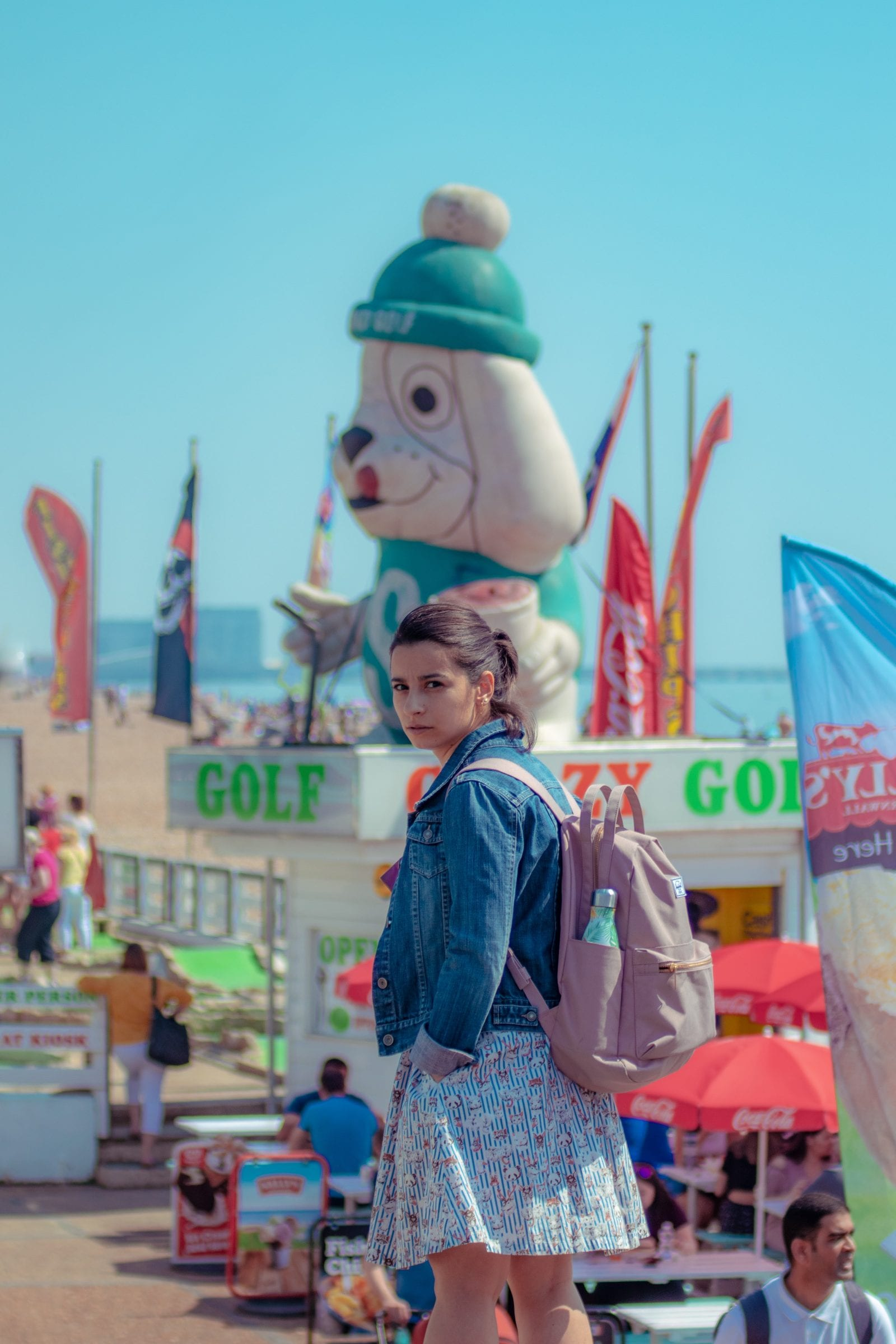 Girl on Brighton seafront one of the colourful places in the uk